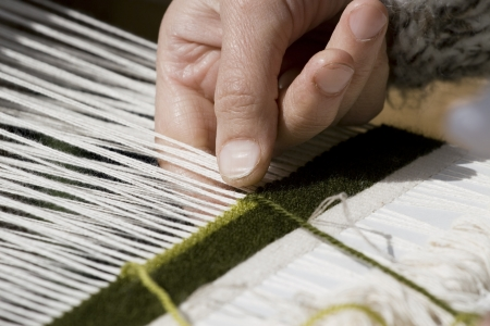 hosiery: Close-up view of handloom weaver hands