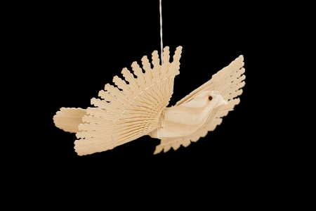 A shot of hand-carved wooden dove hanged on a rope photo