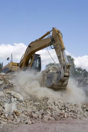 A view of excavator loading debris photo