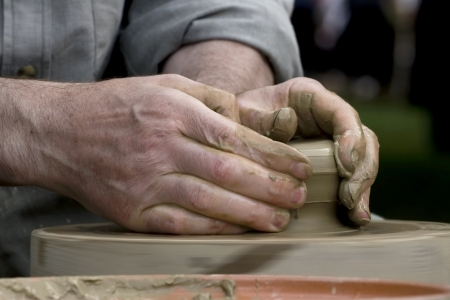 Hands of potter at work Standard-Bild