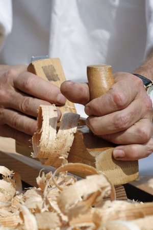 Close-up of carpenter s hands with bench plane at work Stock Photo - 14555013