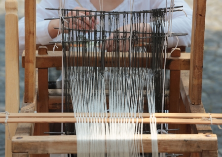 weaving: Front view of an old hand loom weaving machine Stock Photo
