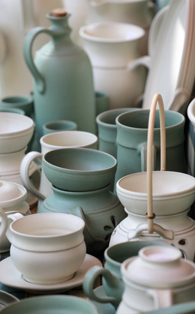 Collection of folk clay cermic colored green and white