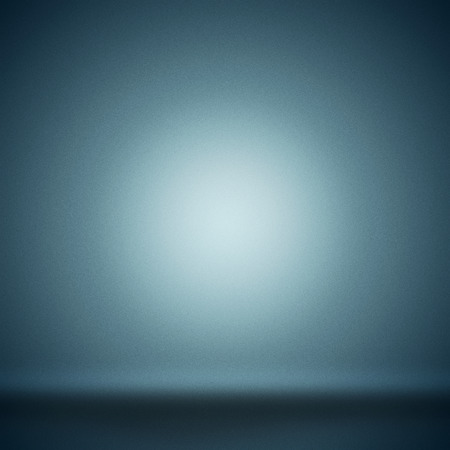 Abstract blank background toned blue with grain and circle spotlight.