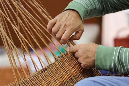 wicker work: Close-up shot of basker maker hands at work Stock Photo