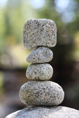 Stacked stones on sunny blurry background Standard-Bild