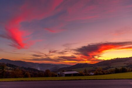 Multi colored sky of hill Velka Lhota Beskydy area sky and clouds play with many colors with view to surround the nature area around many small hills and mountains around capturing during sunset. 写真素材