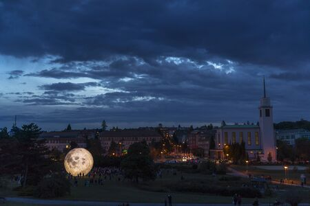 Event City Observatory Brno Kravi Hora timelapse of people moving with Lunalon artificial moon during the evening with the transition into the night when the moon and the city light up.