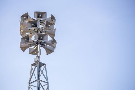 tower with bunch of loudspeakers for communication and announcing