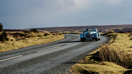 on the lonely road: Car on a lonely road in the Moor