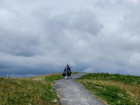 lone: Lone Bagpiper in the Highlands - Scotland Editorial