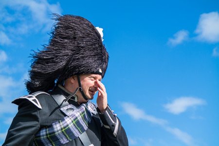 dresscode: Traditional Scottish bagpiper in full dresscode Stock Photo