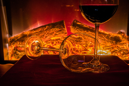 Wine with open fire in background Stock Photo