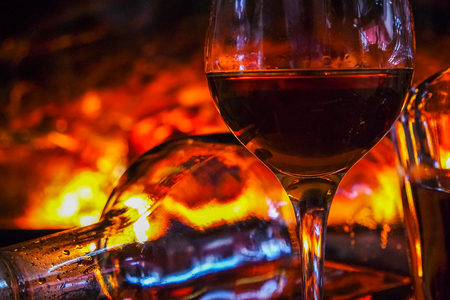Alcoholic drink background with open fire .