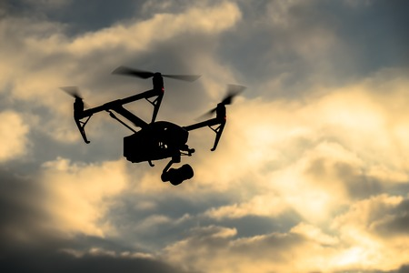 inspiring: Drone silhouette flying in the evening sky