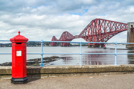 Red letterbox and Firth of Forth rail bridge
