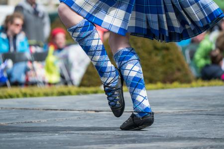 Highland dancer at highland games in scotland, UK Stock Photo