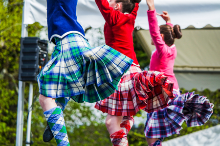 Highland dancer at highland games in scotland