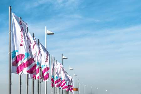 COLOGNE  GERMANY - MARCH 15 2017: Eurowings flags at Cologne Bonn Airport terminal during the strike