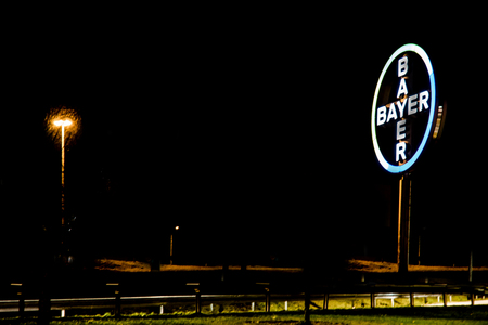 COLOGNE  GERMANY - MARCH 15 2017: Bayer cross shining during night at Cologne Bonn Airport Editorial
