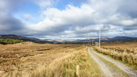 Single track road through the mountains of Kerry Stock Photo
