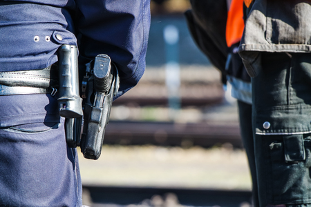 German police man with the blue jacket and gun