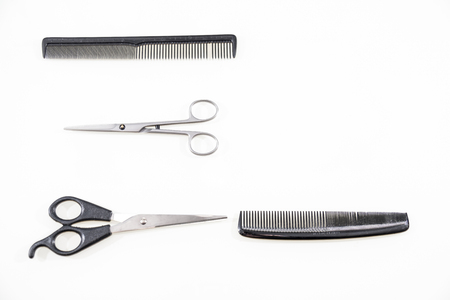 comb: Hair cutting shears and comb isolated on white background