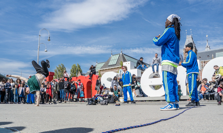 ajax: Amsterdam  Netherlands - April 31, 2017 - The Ajax Amsterdam breakdancing group performing in the city at the I amsterdam letters Editorial