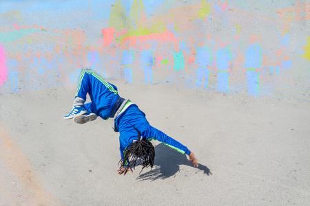 Breakdancer performing in the street Stock Photo