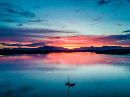 Mull: Aerial of an amazing sunset with sailing vessel Loch Creran, Barcaldine, Argyll