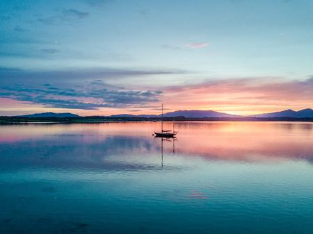 bens: Aerial of an amazing sunset with sailing vessel Loch Creran, Barcaldine, Argyll