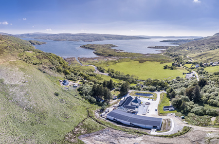 Glenbeg, Ardnamurchan Scotland - May 26 2017 : Ardnamurchan distillery is producing whisky since 2014 and actually expanding their warehouses, aerial Editorial