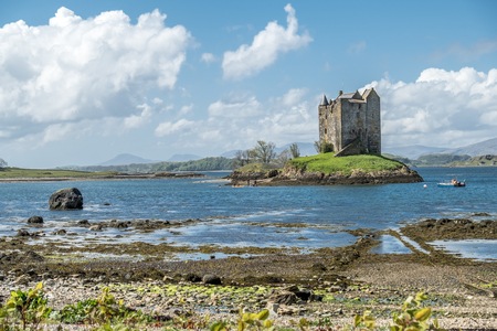 stalker: Canoes gathering at the historic castle Stalker in Argyll Stock Photo