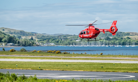 Oban  Scotland - May 17 2017: Red Air ambulance starting to fly back to Ireland Editorial