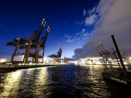 unloading: Hamburg  Germany - July 12 2017: Container gantry cranes of the terminal Eurogate unloading ships in the deepwater port Hamburg-Waltershof Editorial