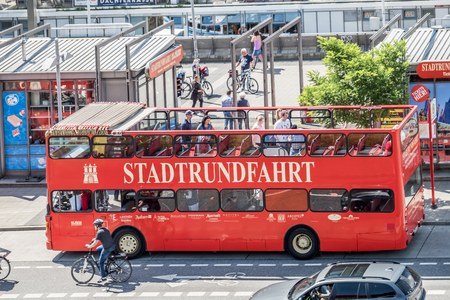 Hamburg , Germany - July 14, 2017: Passengers getting on the red city tour bus