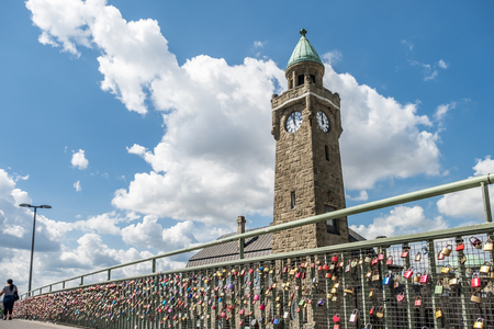 clamped: Hamburg  Germany - July 14, 2017: Thousands of love locks clamping at the bridge to the St. Pauli piers