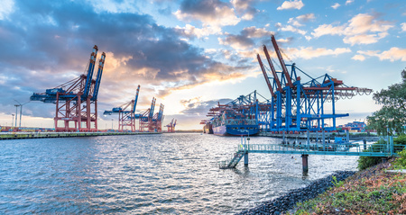 unloading: Hamburg  Germany - July 12 2017: Container gantry cranes of the terminal Eurogate and Burchardkai getting ready for unloading ships in the deepwater port Hamburg-Waltershof Editorial