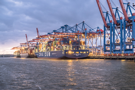 Hamburg  Germany - July 12 2017: Container gantry cranes of the terminal Burchardkai unloading ships in the deepwater port Hamburg-Waltershof at night