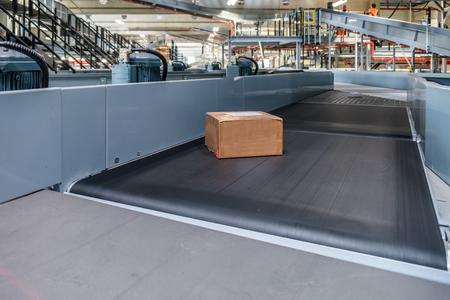 Single parcel transported on conveyor