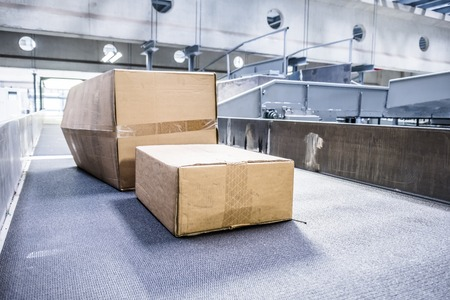 Parcels transported on conveyors
