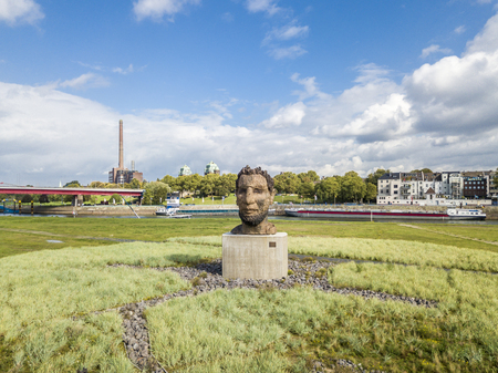 stell: Duisburg  Germany - October 03 2017 : The sculpture Echo of the Poseidon created by Markus Lueppertz is greeting mariners on the mercator island