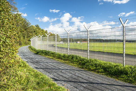 airstrip: Fence around restricted area Stock Photo