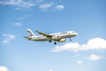 Duesseldorf  Germany - October 05 2017: Aegan Air Airbus A320 landing at Dusseldorf Airport