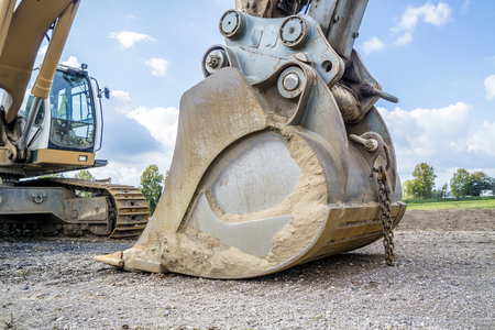 Excavator shovel resting on the ground