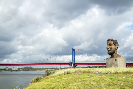 Duisburg  Germany - October 03 2017 : The sculpture Echo of the Poseidon created by Markus Lueppertz is greeting mariners on the mercator island