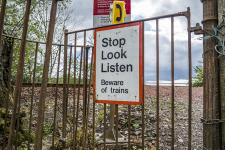 tresspass: Loch Awe, Argyll  Scotland - May 15 2017 : Sign with instructions how to tresspass the railway Editorial