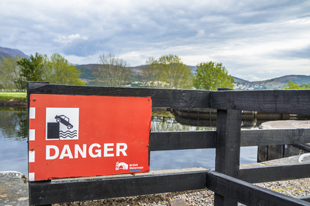 Fort William / Scotland - May 19 2017 : Sign warning of the danger of falling into the water Redakční