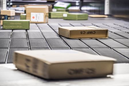 Blurry parcels on conveyor belt Stock Photo