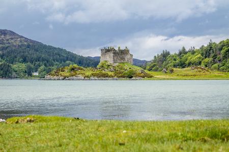 Castle Tioram - a ruined castle on a tidal island in Loch Moidart, Lochaber, Highland, Scotland Stock Photo